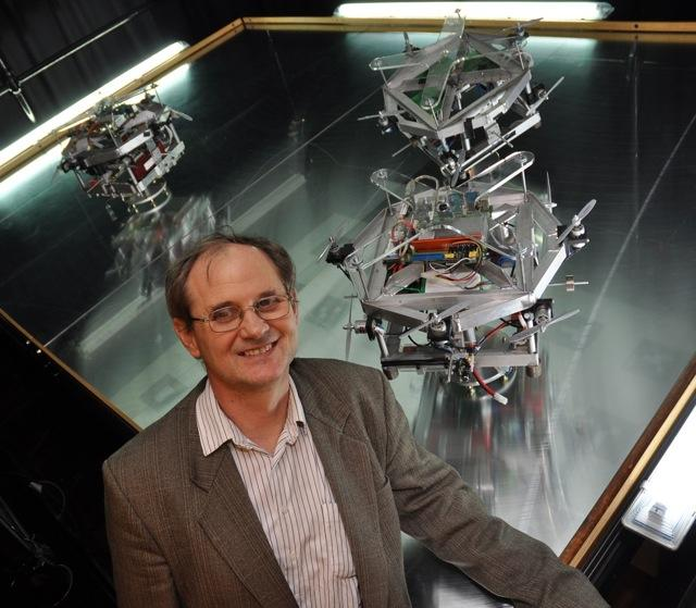 Southampton team leader Professor Sandor Veres, with the model satellites used to test sysbrain