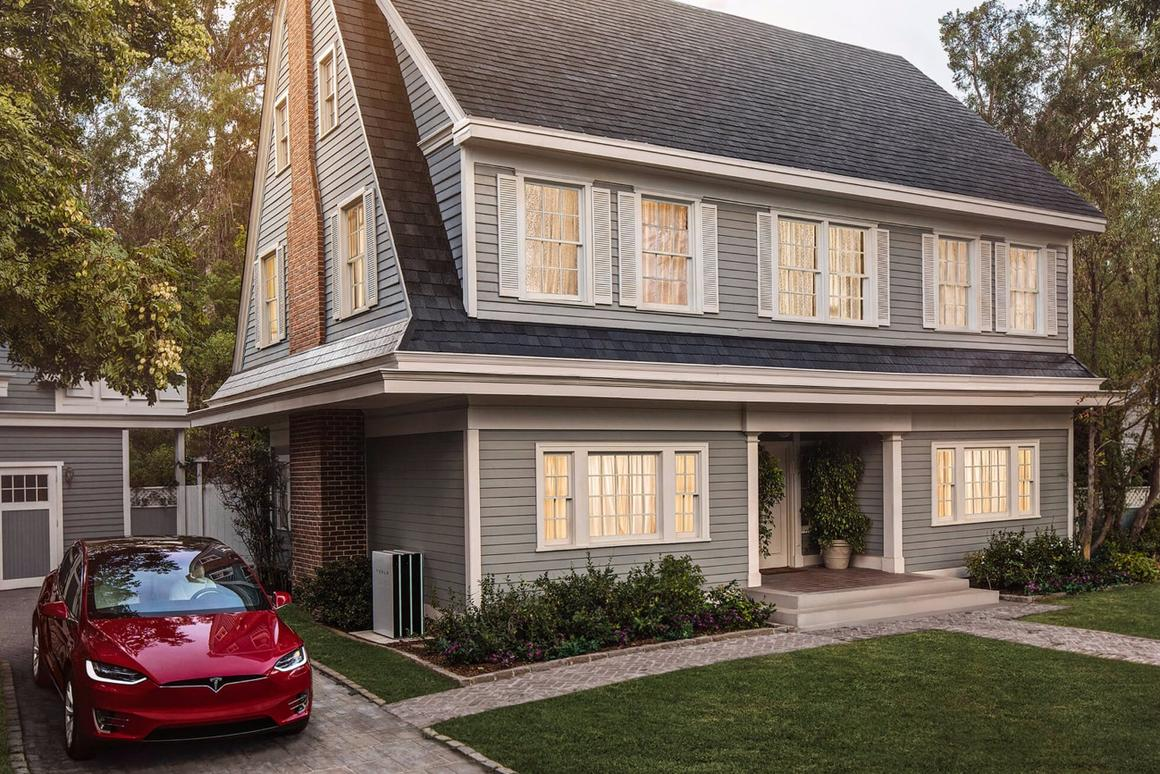The glass tiles look unremarkable (though pretty) from street level, but perform the role of capturing the sun's energy for storage in Tesla's Powerwall 2