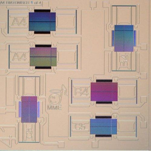 Top view of the Micronium chip, which sports six tiny mass-spring systems. The colors are caused by an optical effect: the rectangle representing the mass has tiny holes in it, causing reflection of light.