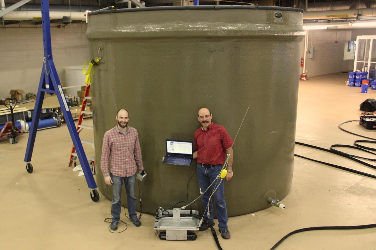Paul Panetta (right) and colleague Dale McElhone with the Acoustic Slick Thickness ROV, in front of a testing tank (Photo: VIMS)