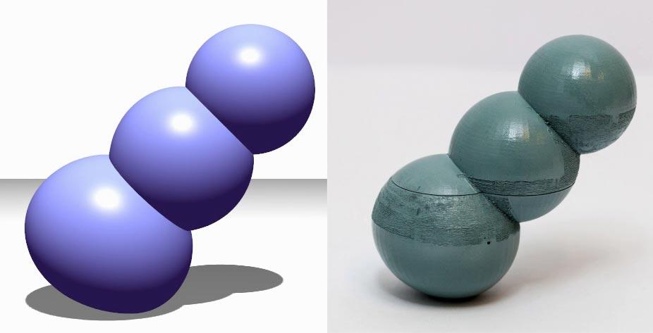 A set of three spheres stands at an angle using the Make It Stand software