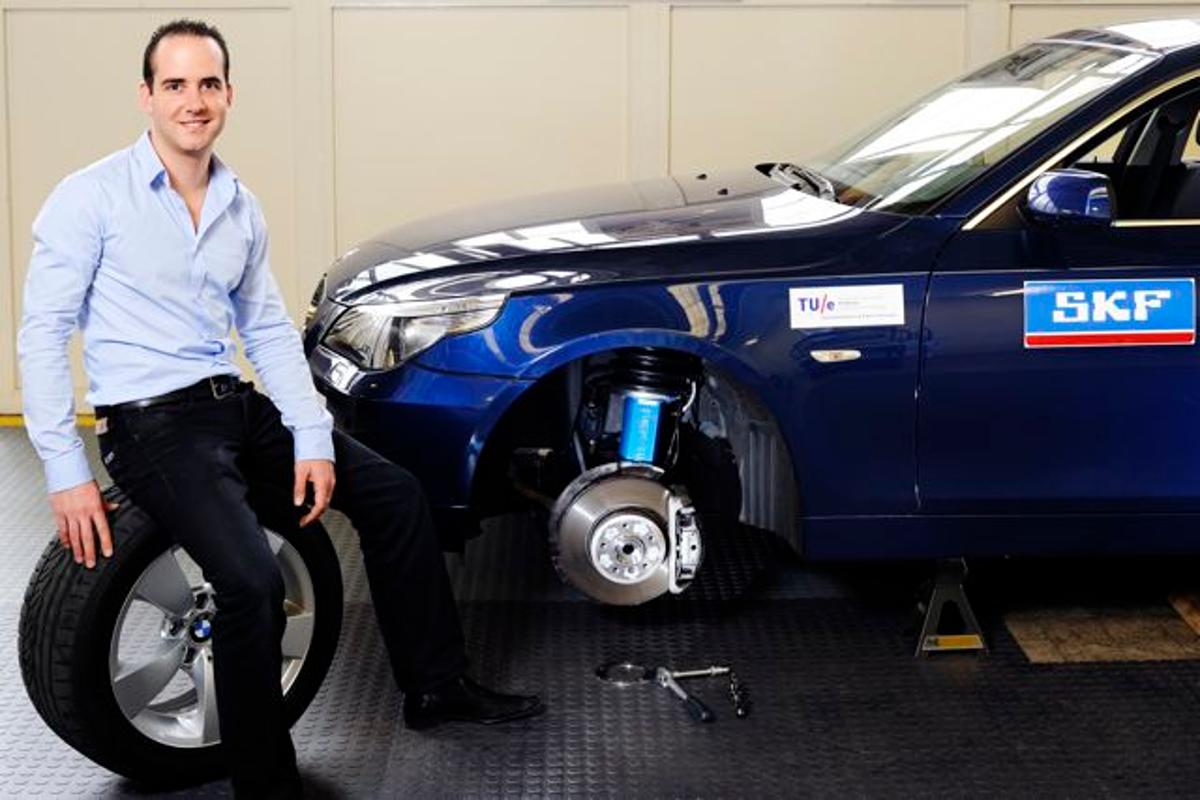 Eindhoven University researcher Bart Gysen and a test car fitted with the new suspension system