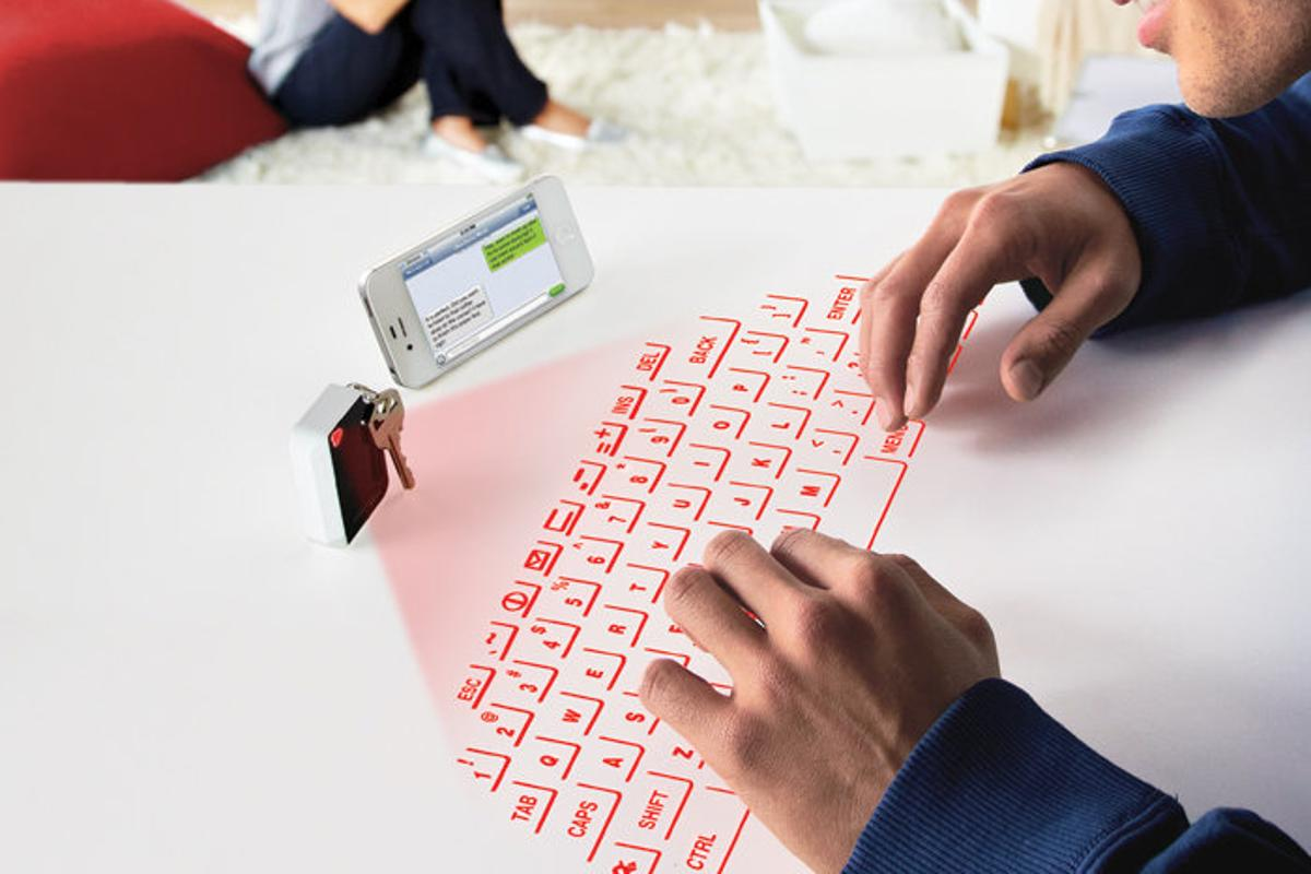 CTX's Virtual Keyboard projects a usable laser outline of a QWERTY keyboard onto any flat surface while fitting inside a small keychain