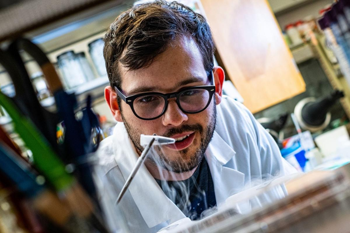 Rice University researcher Ian Campbell, with a vial of ferredoxin proteins