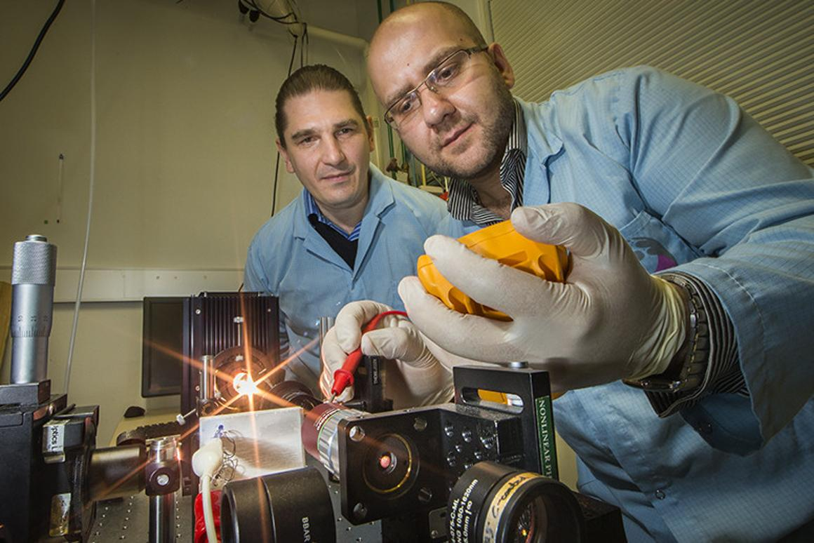 Researchers Andrey Miroshnichenko (left) and Mohsen Rahmani (right) demonstrate the new nanomaterial