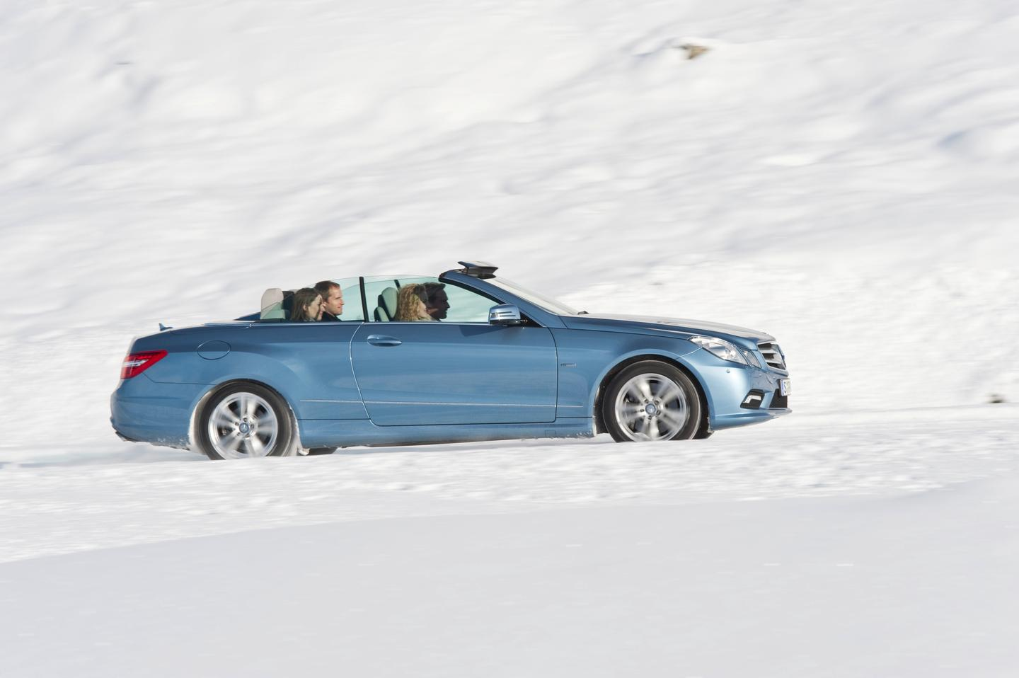 The Mercedes-Benz 2011MY E-Class Cabriolet, with AIRCAP deployed above windshield and between back seats