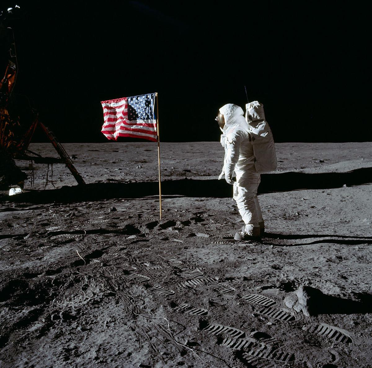 Buzz Aldrin planting a US flag on the Moon – for purely symbolic purposes of course