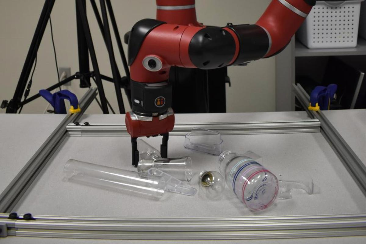 A Sawyer robot utilizes the technology to ascertain the three-dimensional shape of transparent objects, thus allowing it to grasp them