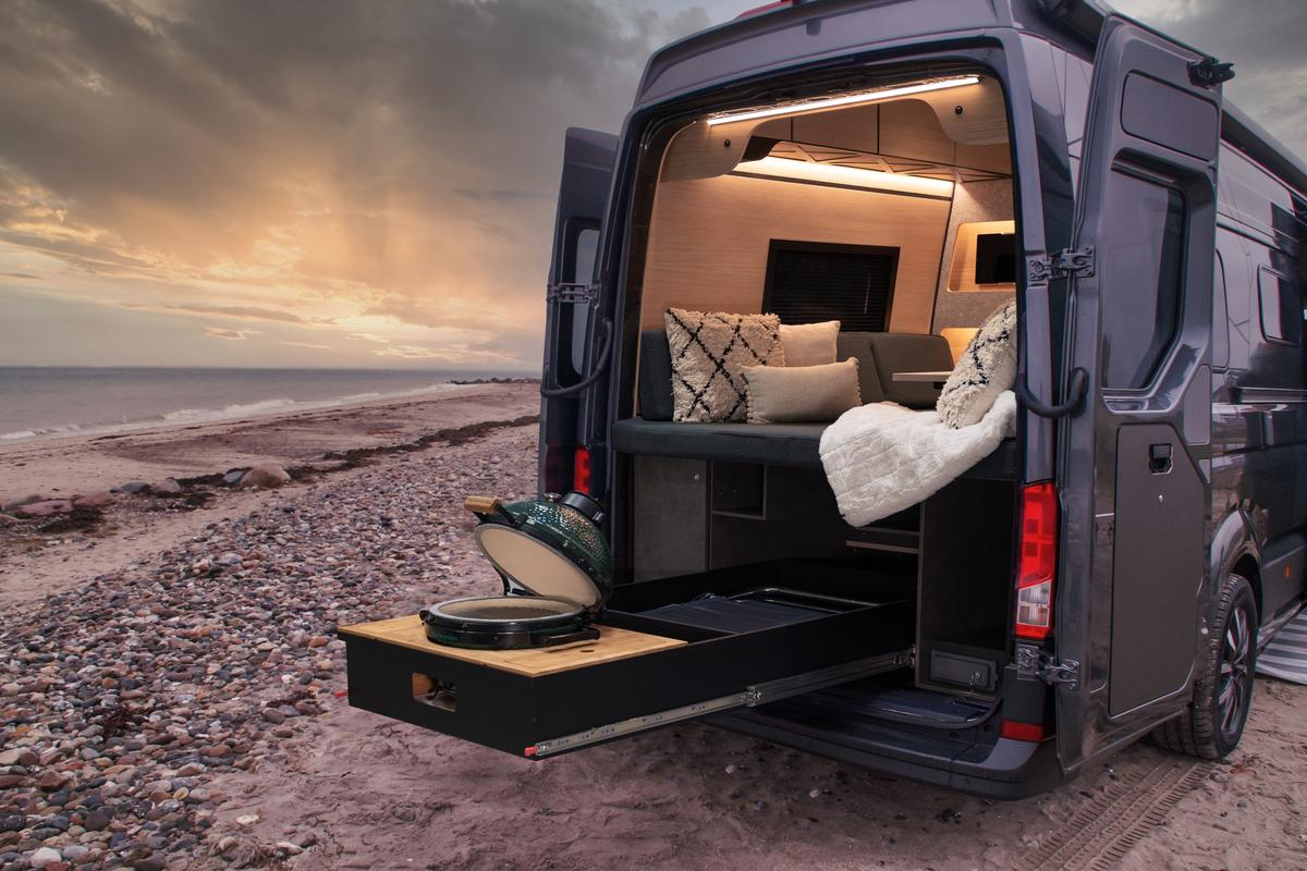 The unequivocal highlight of the Loef camper van package is the rear slide-out Big Green Egg grill