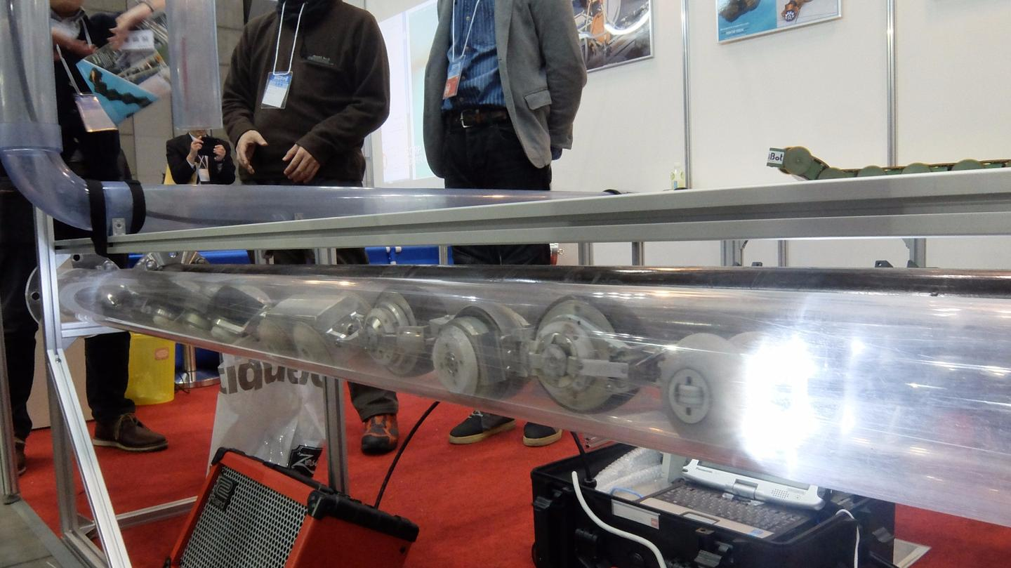 THESBOT moves through a clear acrylic pipe at IREX 2015