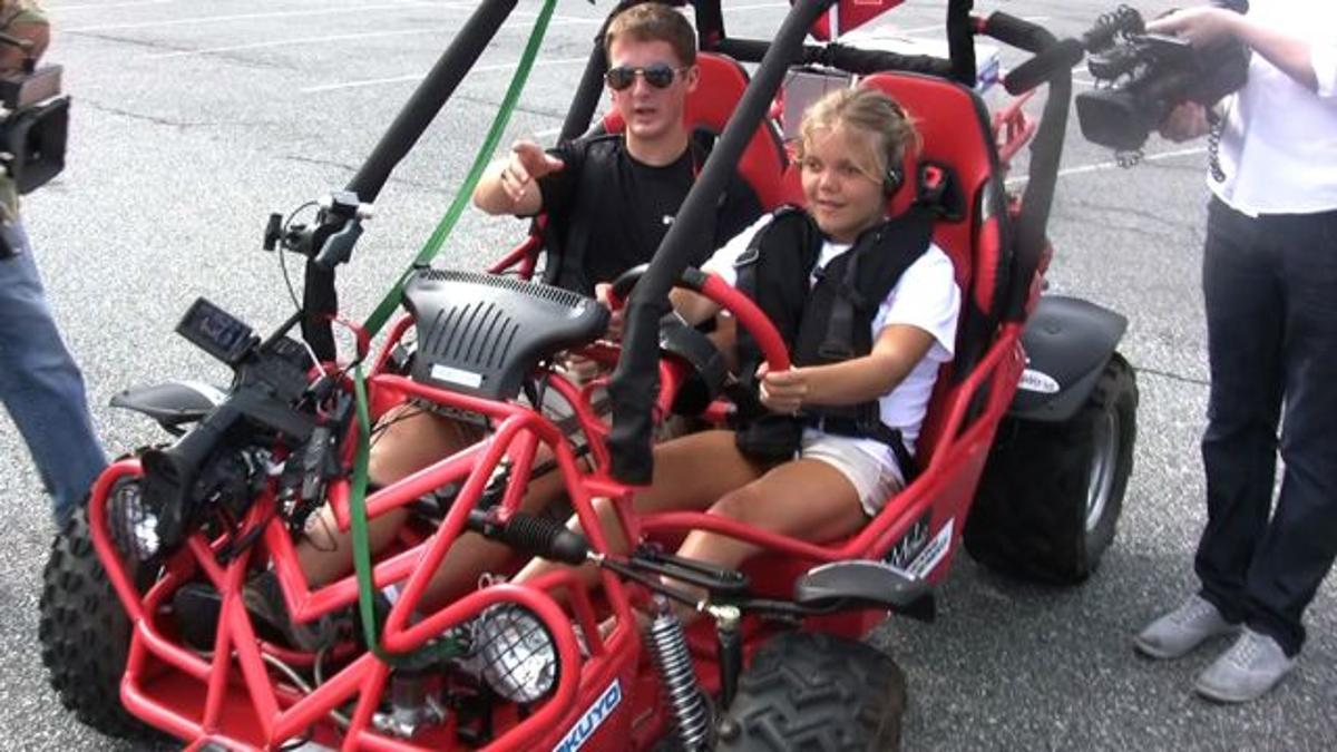 A blind volunteer trying out Virginia Tech's BDC system in a dune buggy
