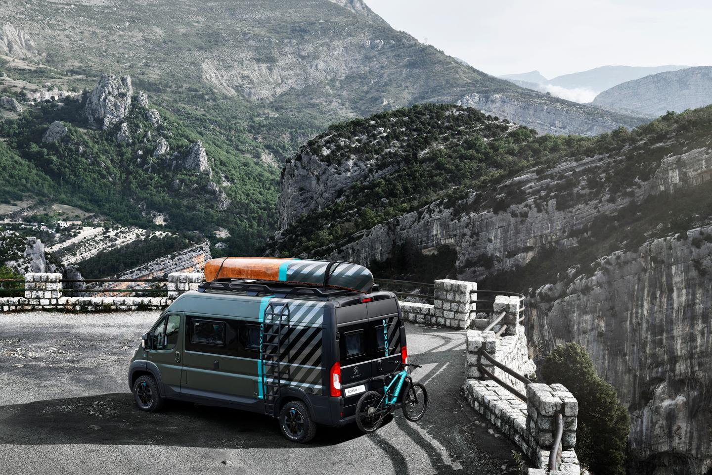 Peugeot Boxer Camper parked on a cliff top road and looking out over the mountains