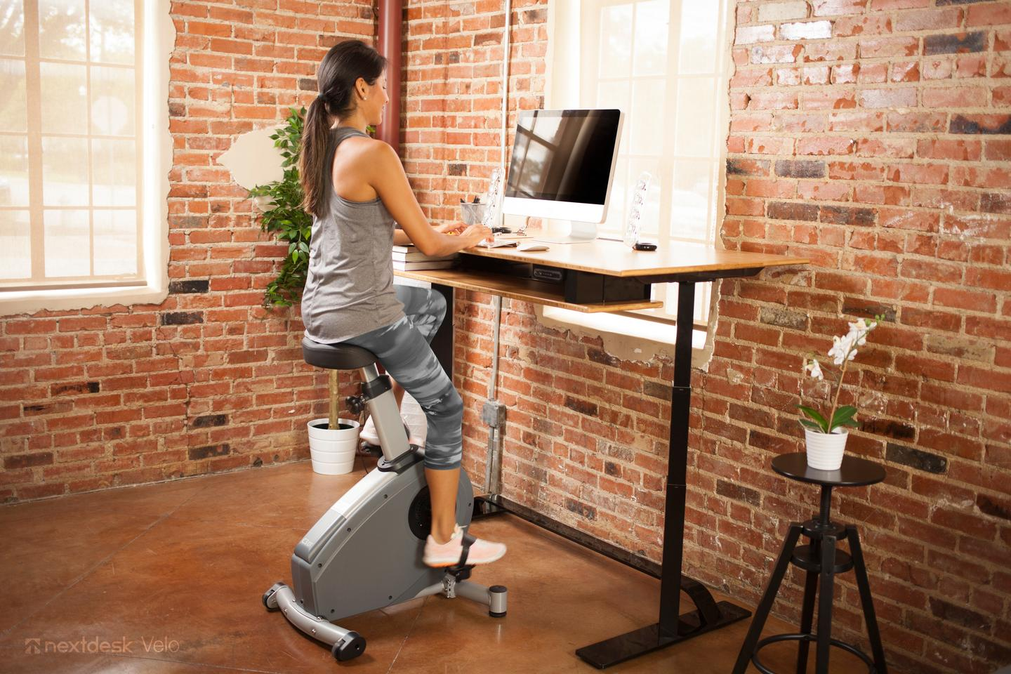 Velo pairs with a standing desk for a sitting workout