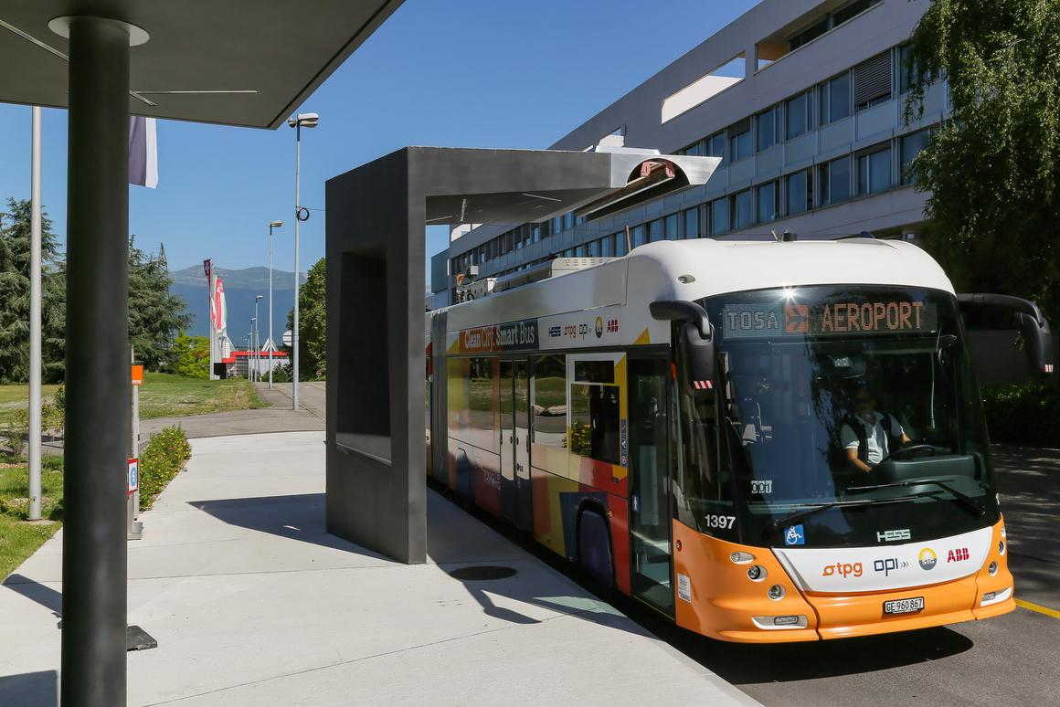 The TOSA buses charge as they stand at a bus stop