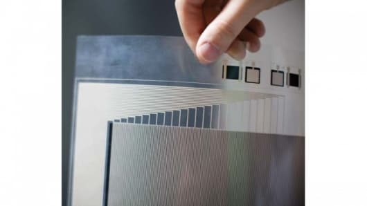 A sheet of plastic that has been imprinted with thin lines of conductive metal (Images: Porter Gifford)