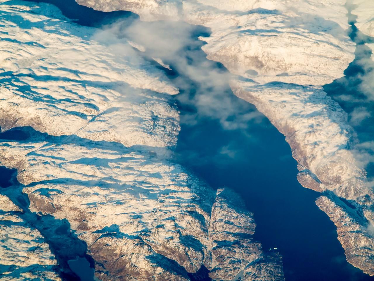 An aerial view of Greenland, where melting glaciers are shrinking faster than they can be replenished