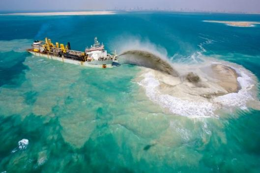 Nakheel's island building methodology involves spraying a mixture of sand and water into place, and after adding hundreds of kilometres to Dubai's coastline, they have it down to a fine art