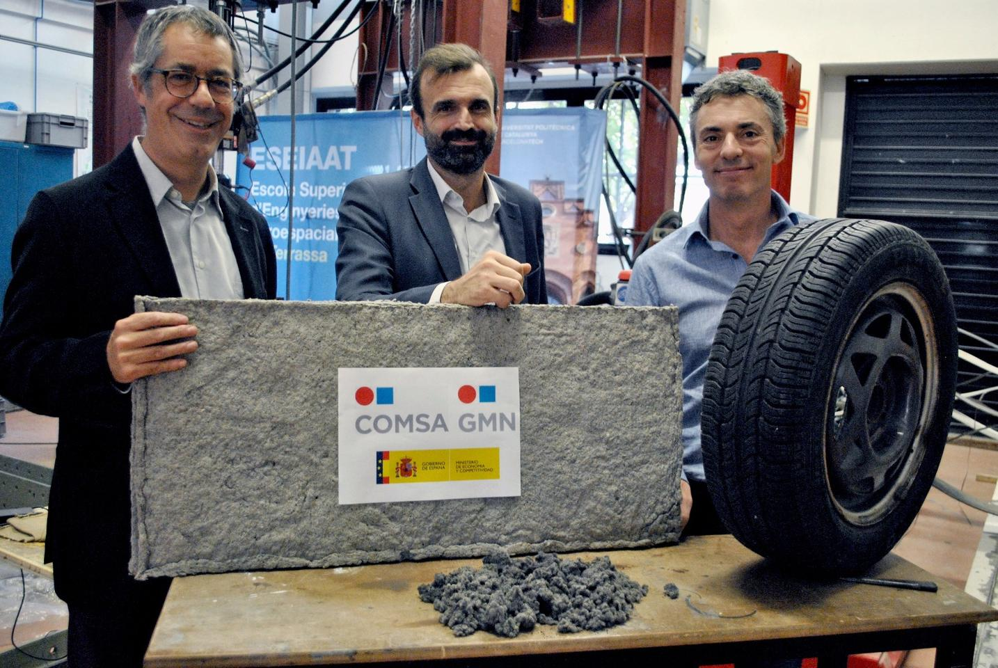 Researchers with a sheet of the tire fiber material