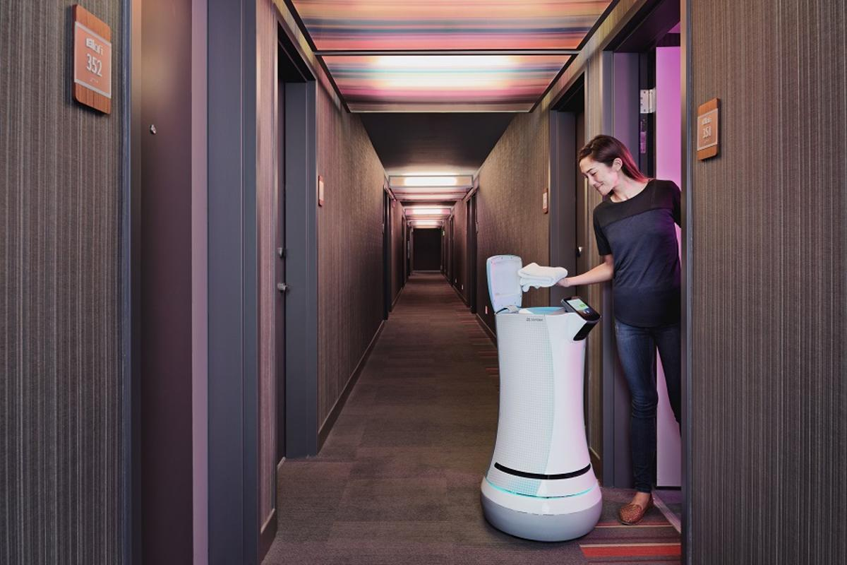 The SaviOne robot can deliver items to guests in hotel rooms
