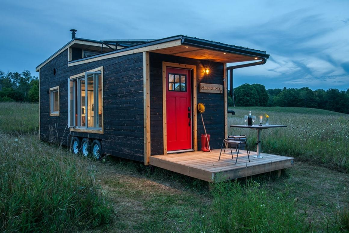 The Greenmoxie Tiny House has a drawbridge deck, which allows the tiny house to remain a reasonable length for towing but then extend when stationary to offer a generous outdoor deck area