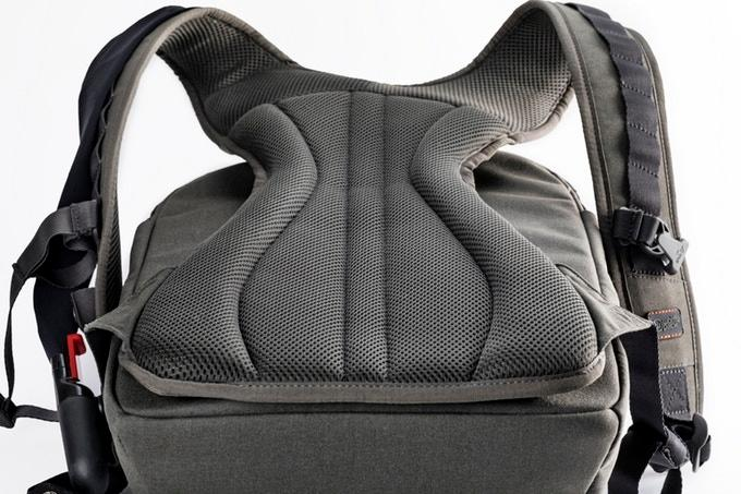 An ergonomic carry frame is home to Wolffepack's novel orbital cord system that allows the main shell to be swung around to the front without having to remove the backpack