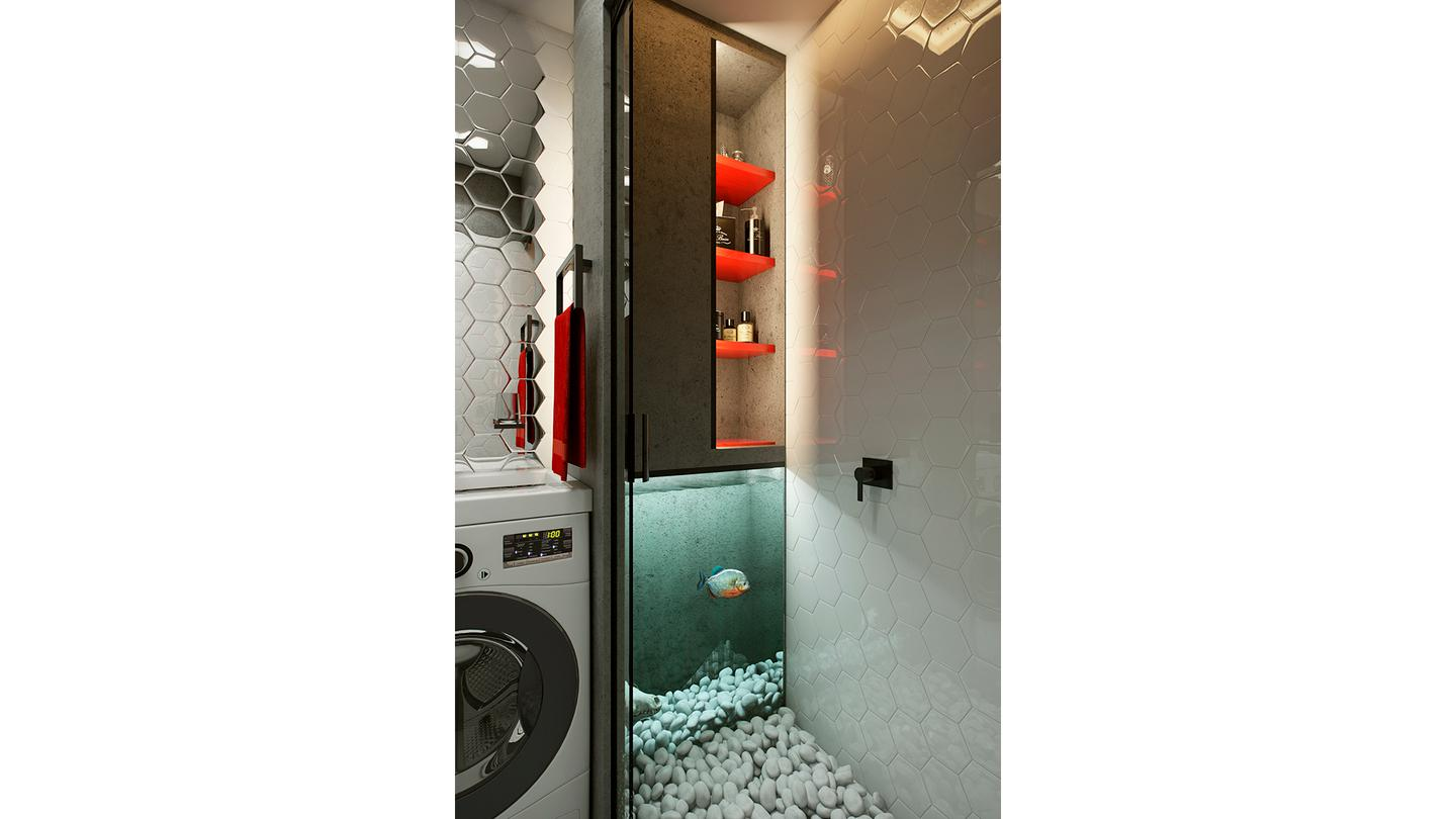 The bathroom includes a fish tank that sits alongside the pebbled shower