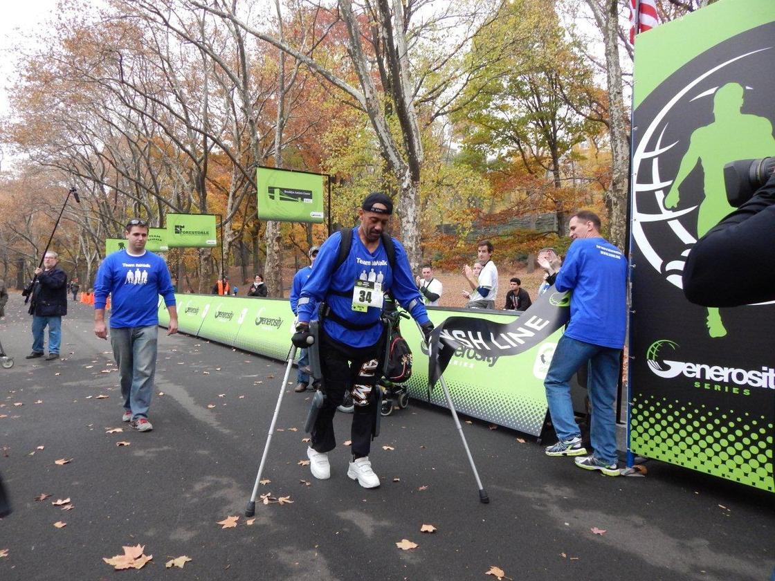 """ReWalker"" Gene Laureano crosses the finish line at the Generosity NYC 5K"