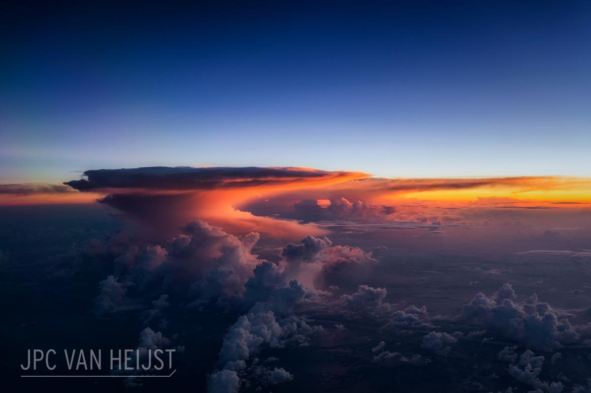 Thunderstorms illuminated by the setting sun over Texas