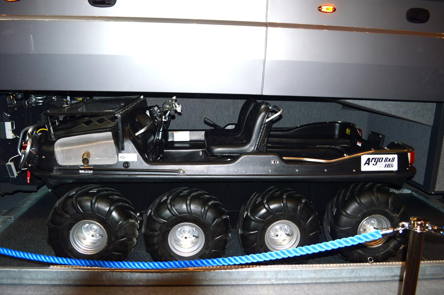 The ARGO 8x8 750 HDi, shown tucked inside a Volkner Mobil RV at the 2013 Dusseldorf Caravan Salon, serves as the powertrain base for the XTI