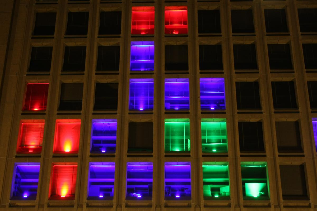 A mysterious group of MIT hackers has taken over the grid of windows on the front of the Institute's Building 54 to create a monster game of Tetris (Photo: Erik Nygren)