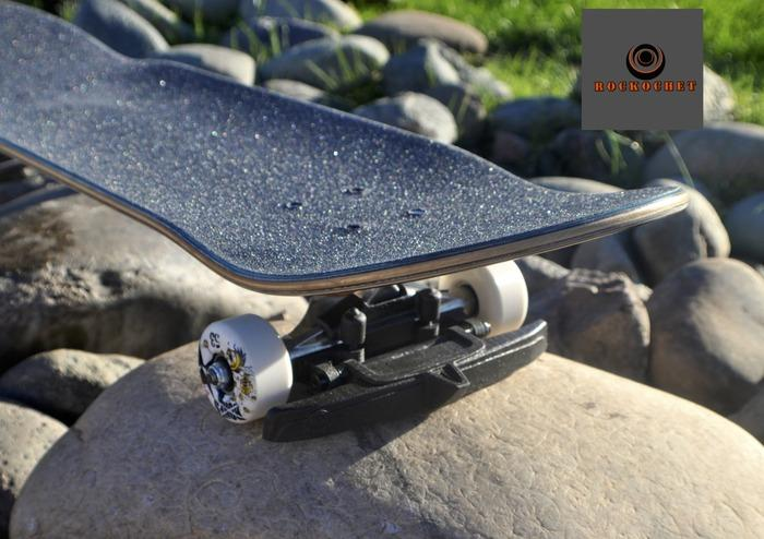 Rockochet mounted to the front of a skateboard