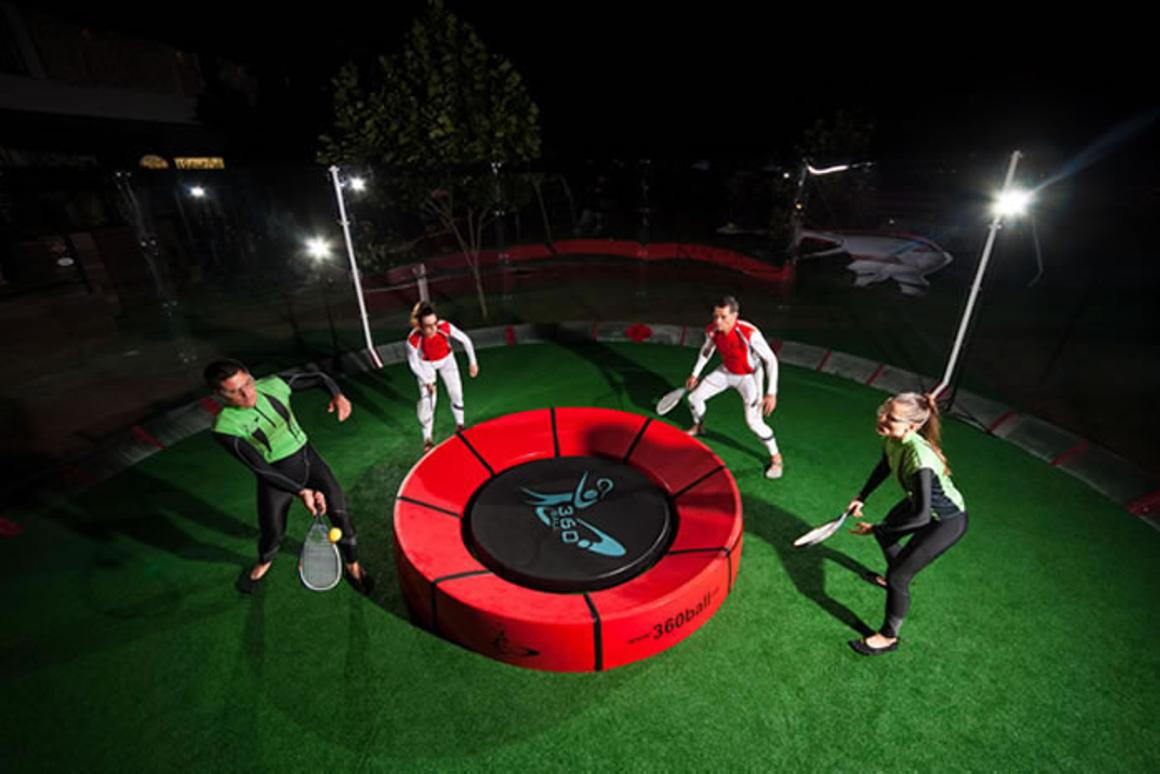 In the new racquet game of 360ball, players hit a ball into a central concave dish, trying to rebound it out of the reach of their opponents