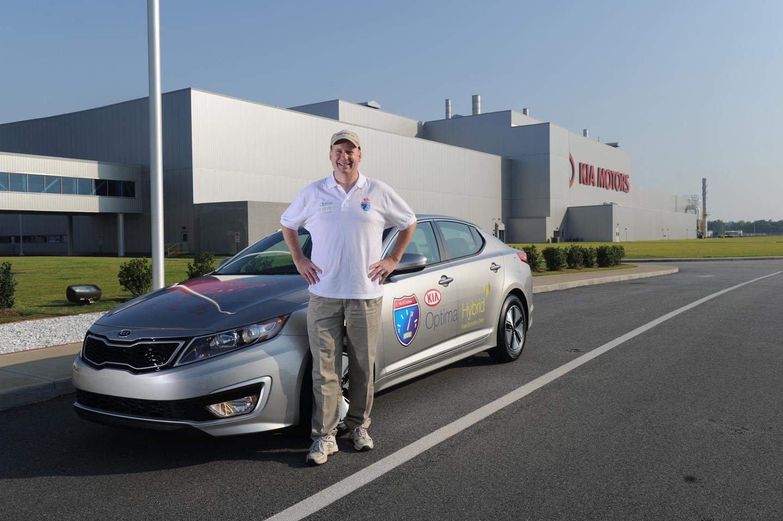 Wayne Gerdes alongside the Kia Optima Hybrid that will take him and Chris Bernius across the contiguous U.S.