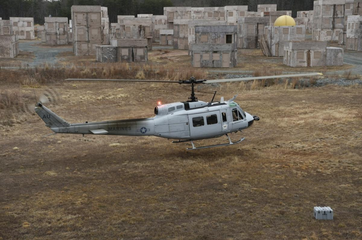 A UH-1 Huey equipped with an AACUS autonomy kit makes an approach for landing during final testing at Marine Corps Base Quantico