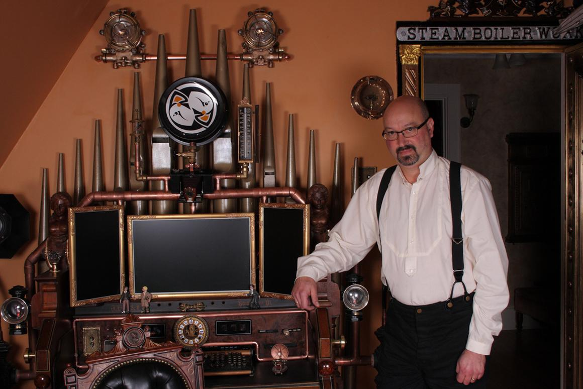 Bruce Rosenbaum alongside his latest creation, the Victorian Organ Command Desk