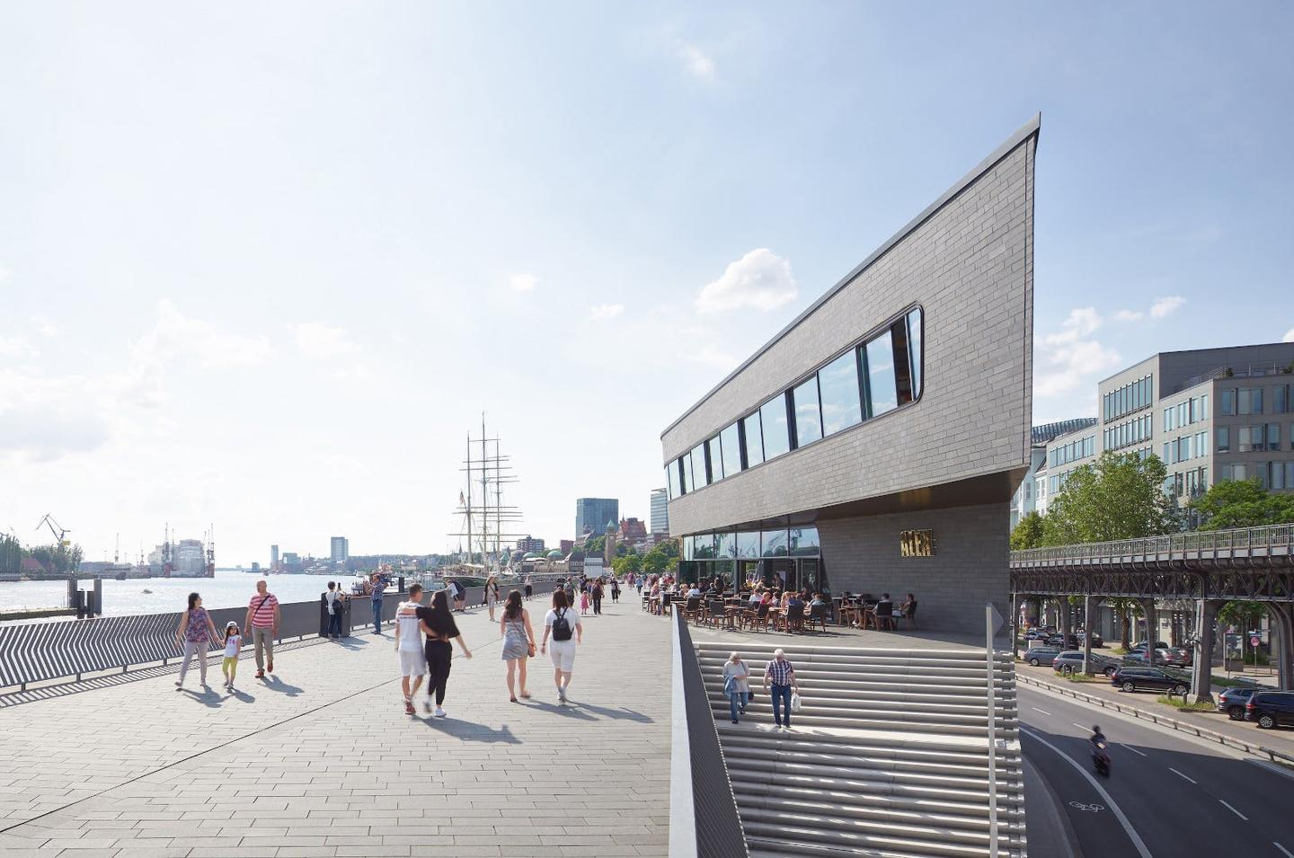 The Niederhafen River Promenade's cantilevering restaurant is three stories tall