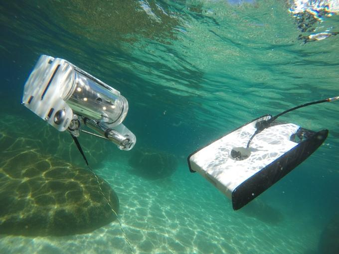 OpenROV's original ROV (left) and the Trident (right)