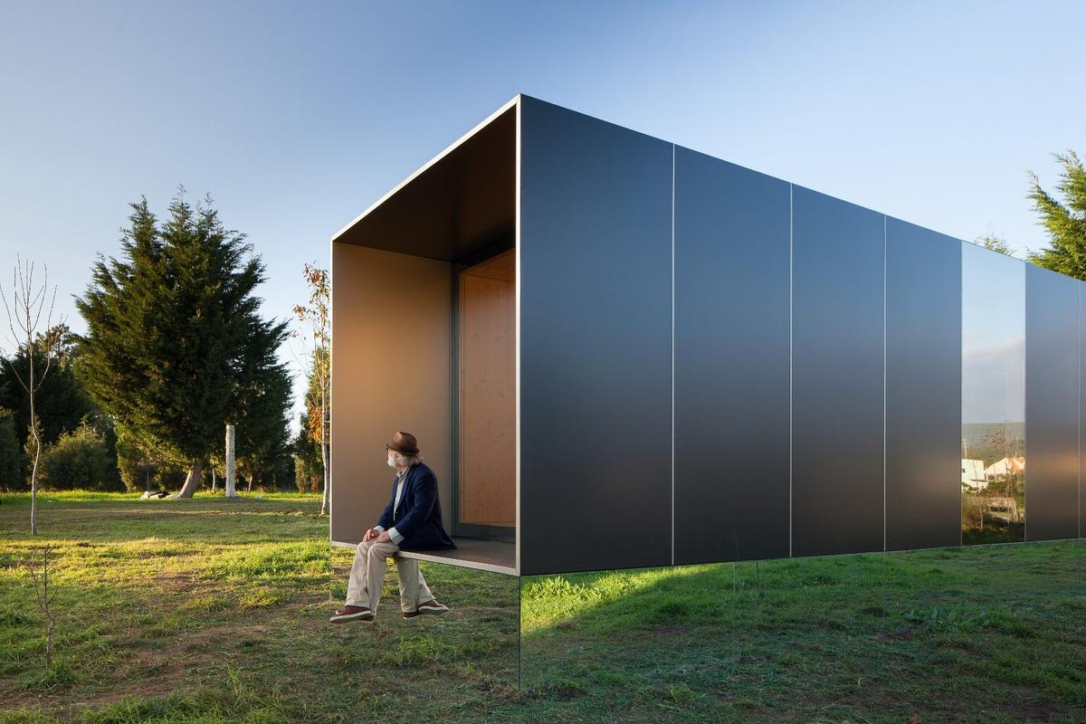Portuguese prefabricated housing firm Mima Housing's Mima Light features a mirrored base section that makes it appear to float in mid-air