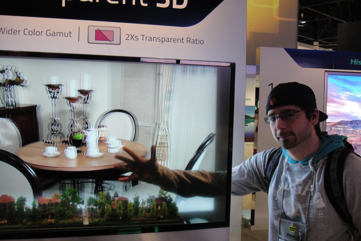 Gizmag's Dave LeClair, demonstrating the transparent 3D TV