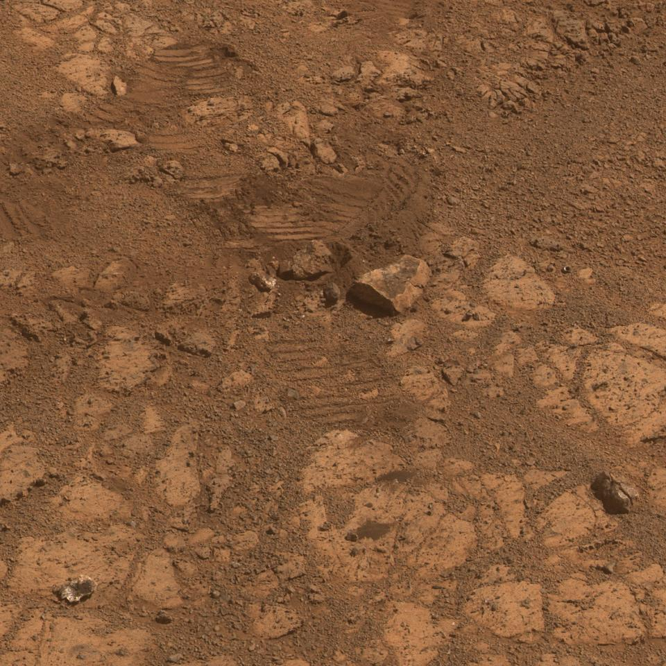 "Opportunity shows where a rock called ""Pinnacle Island"" (lower left corner) had been before it appeared in front of the rover in early January 2014 (Image: NASA/JPL-Caltech/Cornell Univ./Arizona State University)"