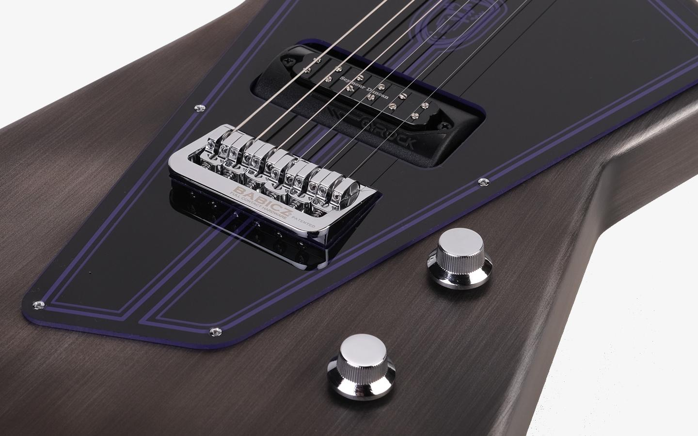 The angular guitar features the Gyrock pickup selection system from Wild Customs, which mounts up to six different pickups to a carousel setup in the body