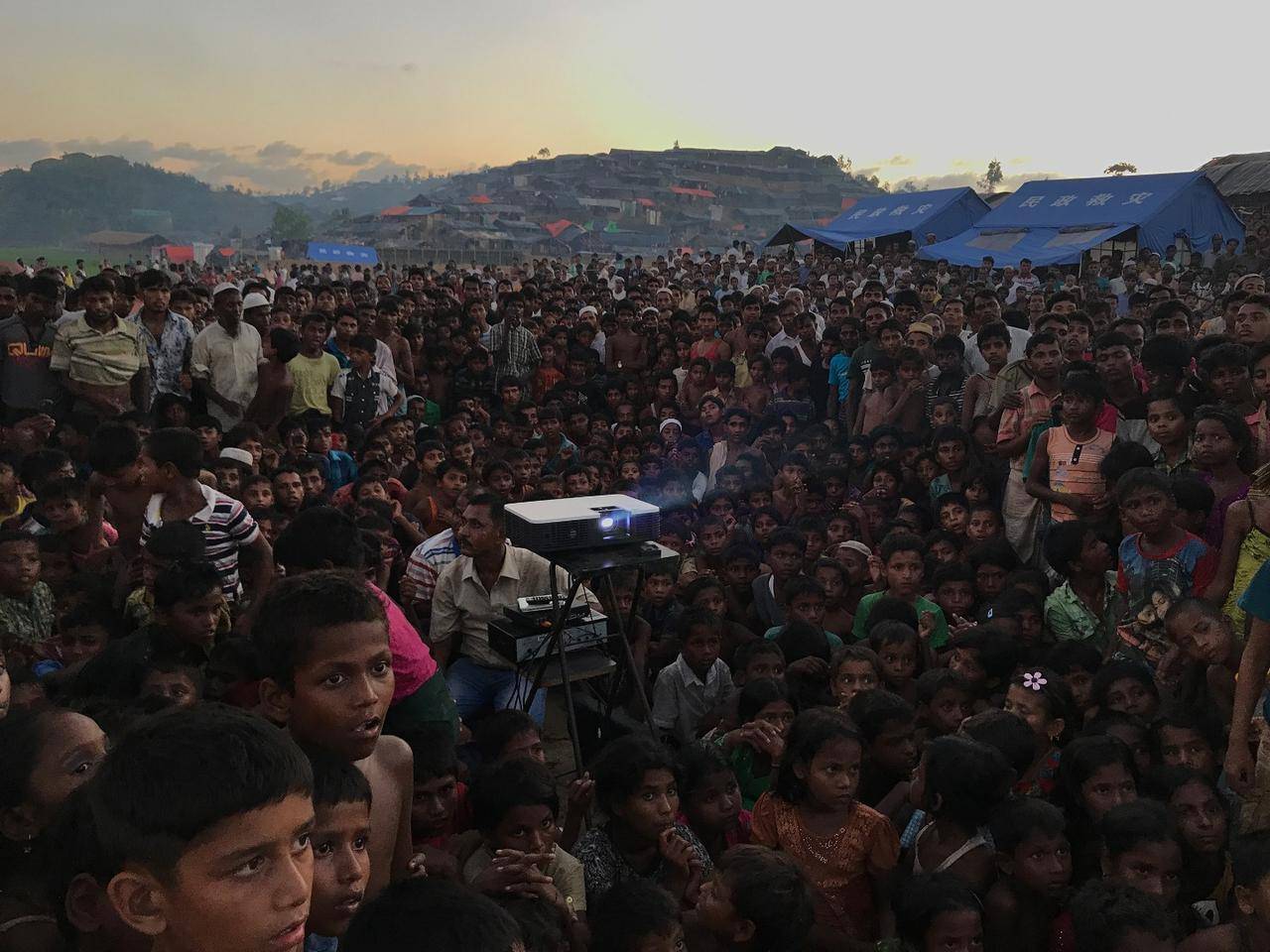 The Grand Prize winner of the 2018 iPhone Photography Awards shows a group of Rohingyan children watching an awareness film about health and sanitation near a refugee camp outside Ukhiya, Bangladesh