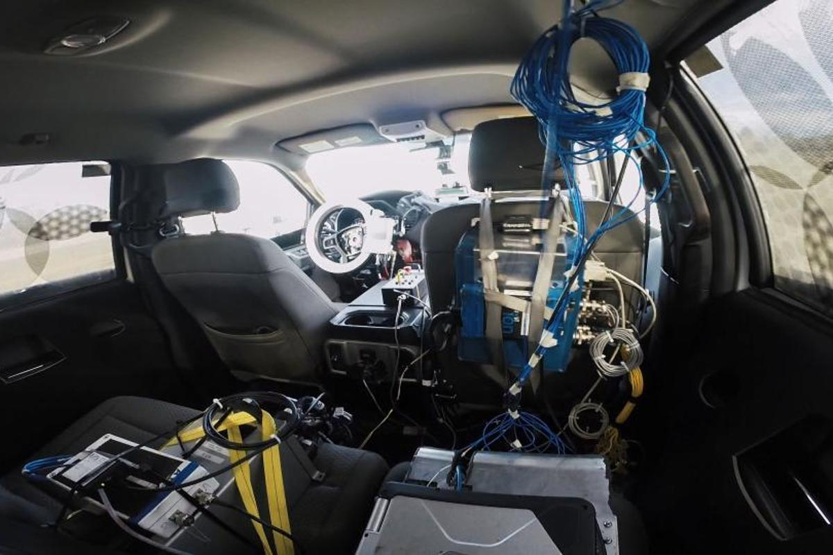 The robotic driving system is designed to be added into any vehicle without requiring refitting of vehicle components