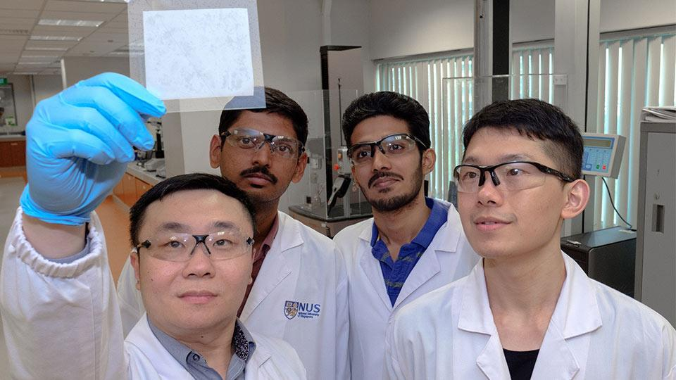 Assistant Professor Tan Swee Ching (left) and his team, with a sample of the hydrogel