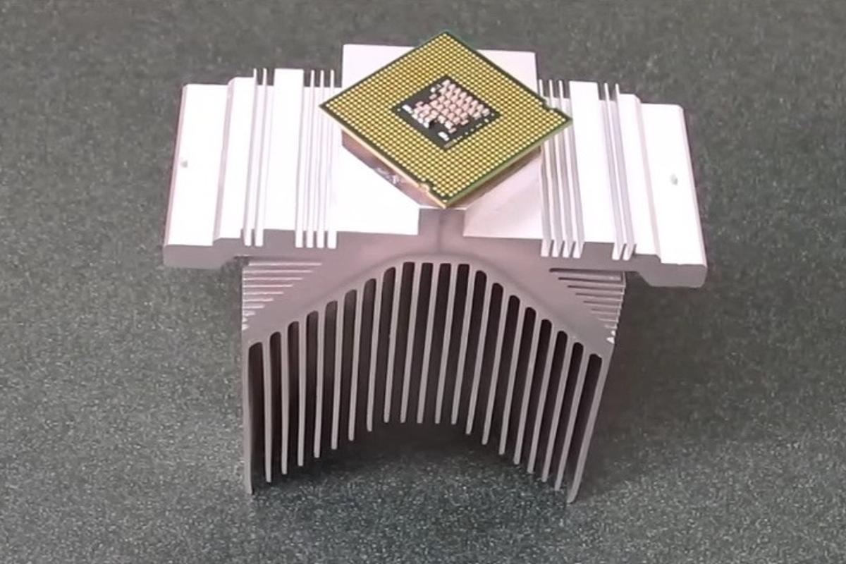 A CPU bonded to a heat sink, using the new glue