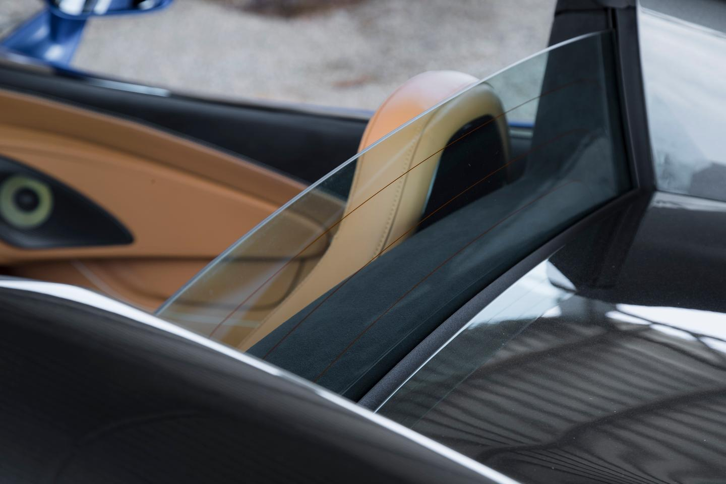 The rear glass behind the driver and front passneger in the McLaren 570S can be raised and lowered independent from the roof, allowing changes in airflow as needed