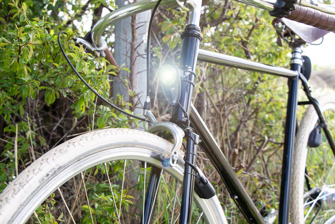 The Reelight Nova headlight, with the no-contactdynamo visible beside the wheel rim