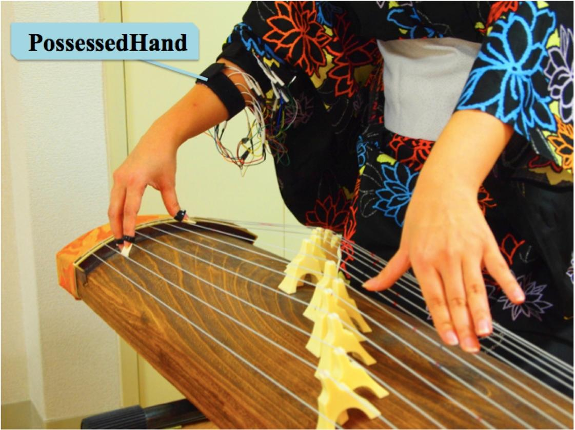 The PossessedHand system uses non-invasive electrical stimulation of muscles in the forearm to control movement of joints in the hand - helping fledgling Koto players learn faster (Photo: Emi Tamaki and Jun Rekimoto / University of Tokyo)