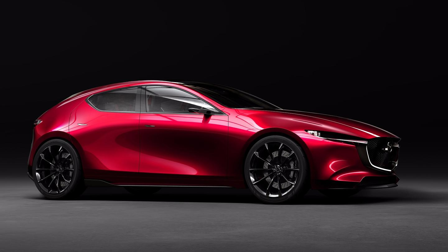 The compact hatchback Kai Concept features a long hood with a sizeable overhang and signature Mazda grille