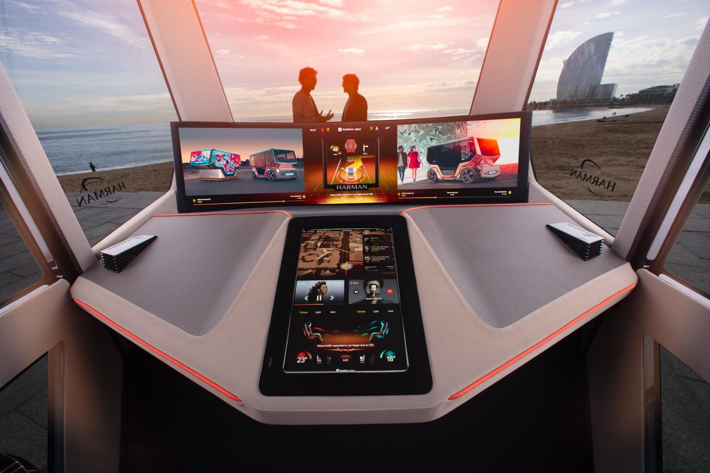 A curved 49-inch LED screen spans the entire width of the microSNAP's cabin